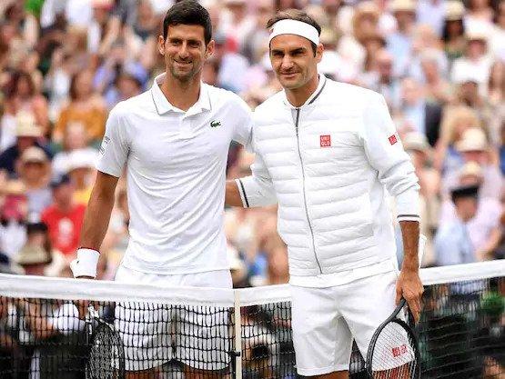 Novak Djokovic e Roger Federer verso le due del pomeriggio del 14 luglio 2019.